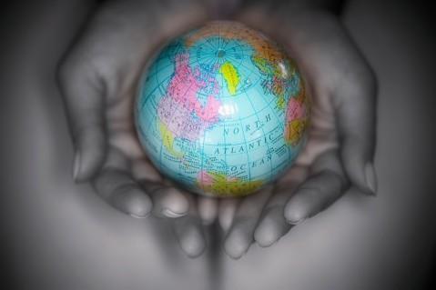 Hands Holding a Small Globe --- Image by © Royalty-Free/Corbis
