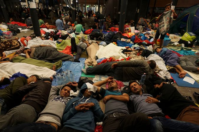 syrian_refugees_having_rest_at_the_floor_of_keleti_railway_station-_refugee_crisis-_budapest_hungary_central_europe_5_september_2015